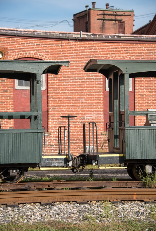 Old narrow gauge railroad cars near the harbor, Portland, Maine, USA