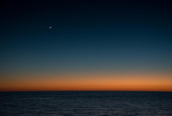 Sunset and new moon, Charleston, South Carolina, USA