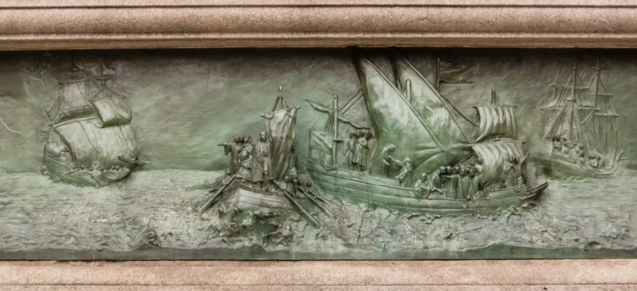 The discovery of the Americas by Columbus, relief sculpture on the base of the statue of Columbus at Columbus Circle, New York, NY, USA