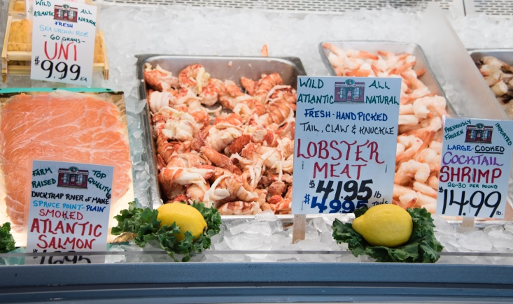 Uni, smoked salmon, LOBSTER MEAT, and shrimp for sale, Harbor Fish Market, Portland, Maine, USA