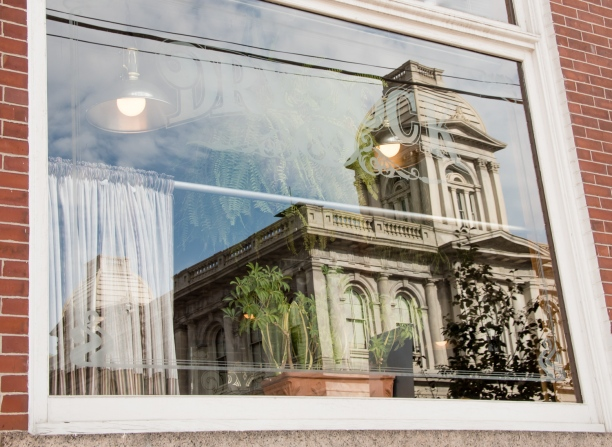 United States Customs House reflected in the window of the Dry Dock Restaurant-Tavern, Portland, Maine, USA