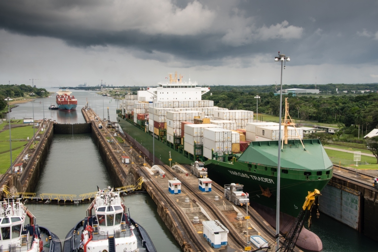 A final view of Colon (on the horizon) -- looking aft from our ship after the water has risen in the middle lock and we begin entering the upper Gatun lock; Panama Canal, Panama