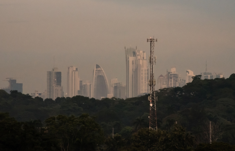A telescopic, twilight view of some of Panama City's new high rises overlooking the Pacific Ocean; Panama Canal, Panama