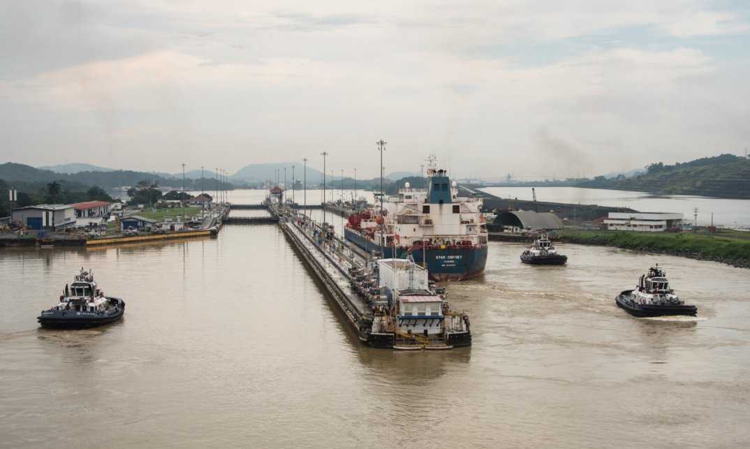 After crossing under the Centennial Bridge we approached the first of three Pacific locks that will lower us 84 feet (25.6 meters) to the Pacific Ocean; Panama Canal, Panama