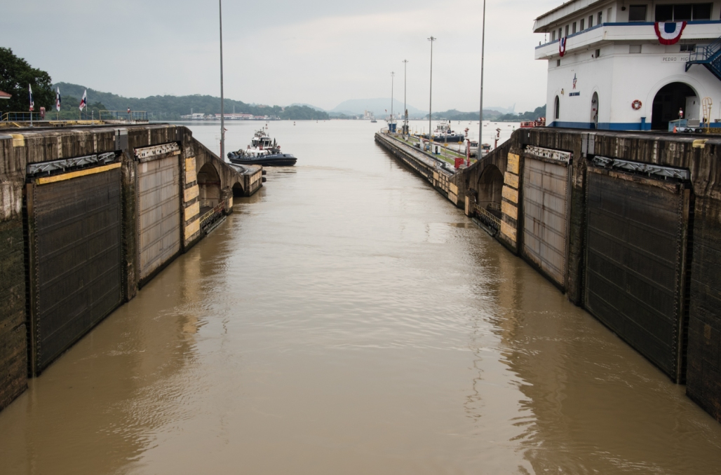 """After the water level in the Pedro Miguel lock was lowered and the gates opened, the """"mules"""" pull us into Miraflores Lake; Panama Canal, Panama"""