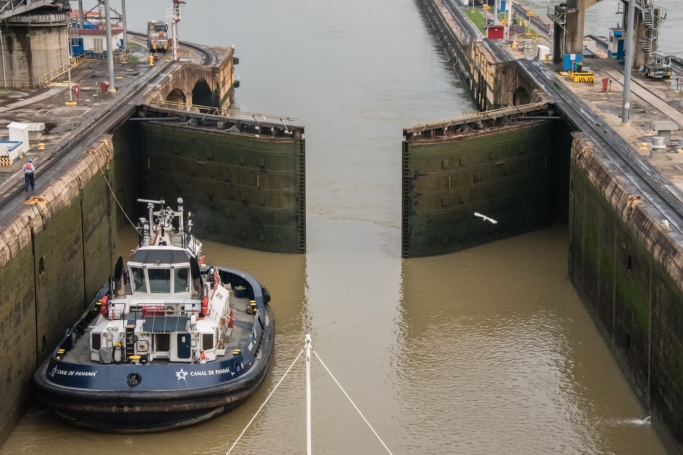 """After the water levels were equalized, the gates are electrically opened and we prepare for the final """"pull"""" from the """"mules""""; Panama Canal, Panama"""