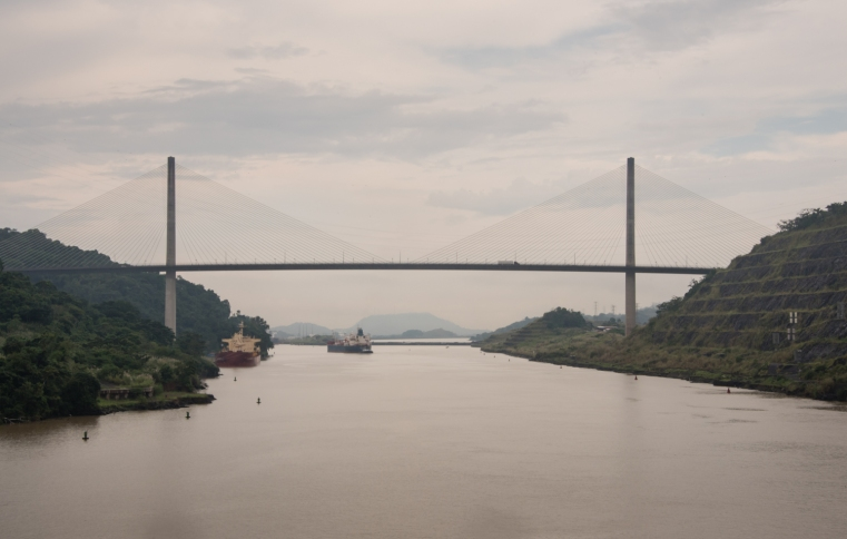 Approaching the Centennial Bridge and, beyond it, the Pacific-locks (three) that will lower us 84 feet (25.6 meters) to the Pacific Ocean; Panama Canal, Panama