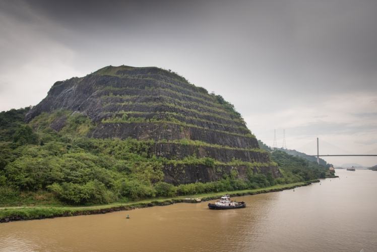 Approaching the Centennial Bridge and the southern section of the Celubra Cut, the site of numerous catastrophic land slides during (and after) construction; Panama Canal, Panama