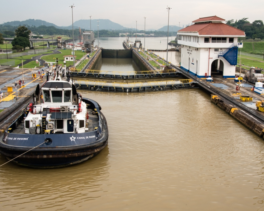 "Being positioned, by the ""mules"", in the first of two Miraflores locks (along with one of the Canal's tugboats); Panama Canal, Panama"