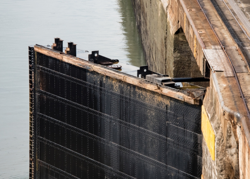 Close up detail of the first lock's hollow, metal gate and the retracting mechanism (on top, right) -- still in use since 1914; Panama Canal, Panama
