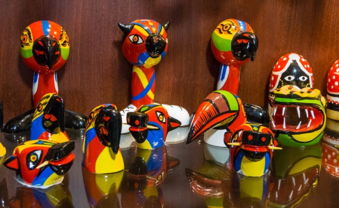 Hand painted local birds and totems at Artesanias de Colombia in El Centro (Old City) Cartagena, Colombia