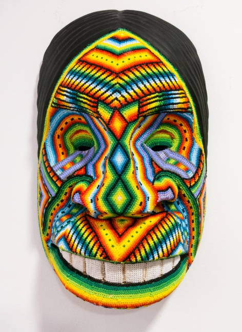 Hand woven beaded mask at Artesanias de Colombia in El Centro (Old City) Cartagena, Colombia