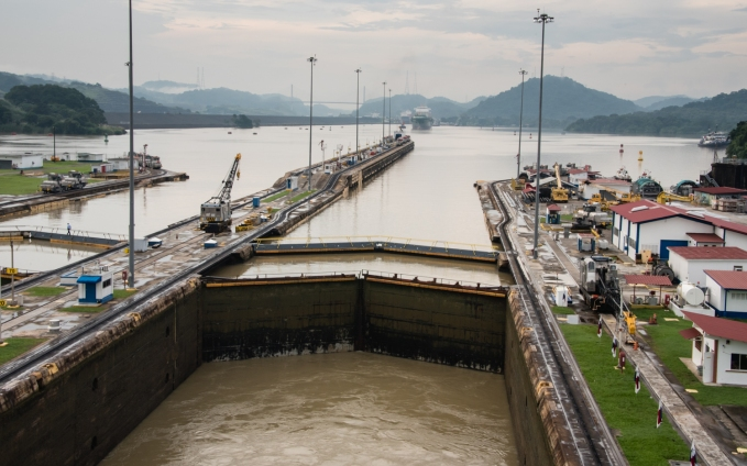 Looking aft from the stern of our ship towards the Centennial Bridge and the Caribbean Sea, from the first Miraflores lock, as the water is drained; Panama Canal, Panama