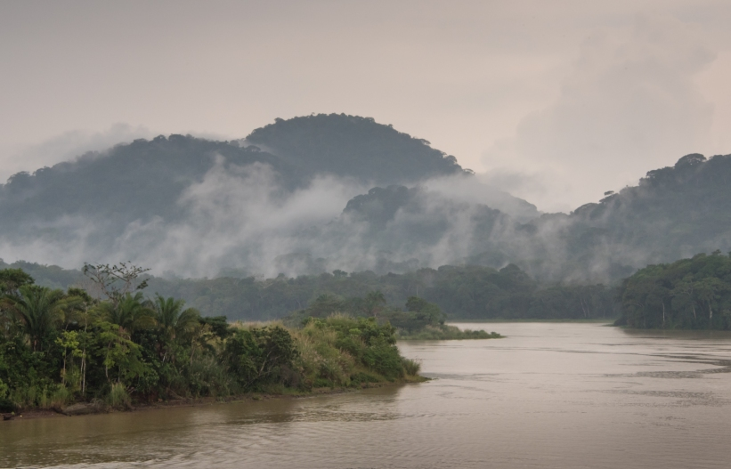 Low mountains of the Continental Divide and rain forest jungle as we sailed past the northern entrance of the Culebra Cut; Panama Canal, Panama