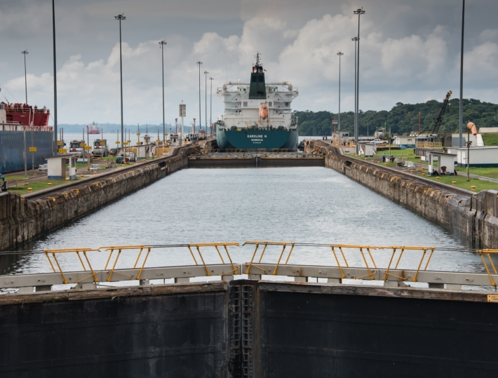 Our ship waiting for the water to rise after we had entered the middle Gatun lock; Lake Gatun is visible beyond the locks; Panama Canal, Panama