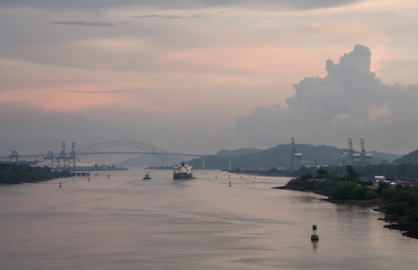 Sailing at dusk towards the Bridge of the Americas and the Pacific Ocean; Panama Canal, Panama