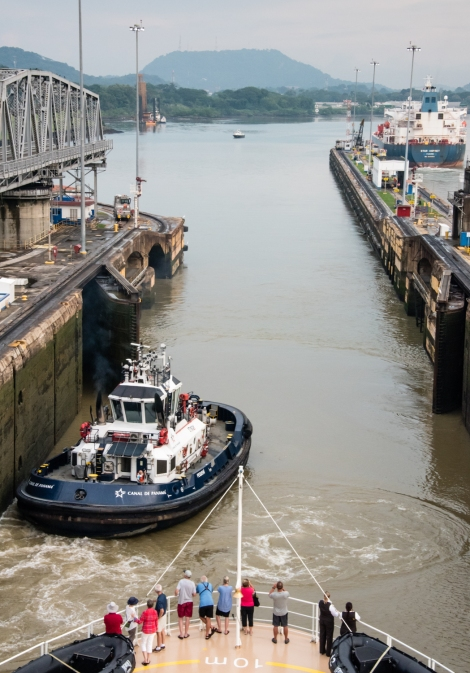 The tugboat that shared these locks with us steams out towards the Pacific Ocean under its own power; Panama Canal, Panama