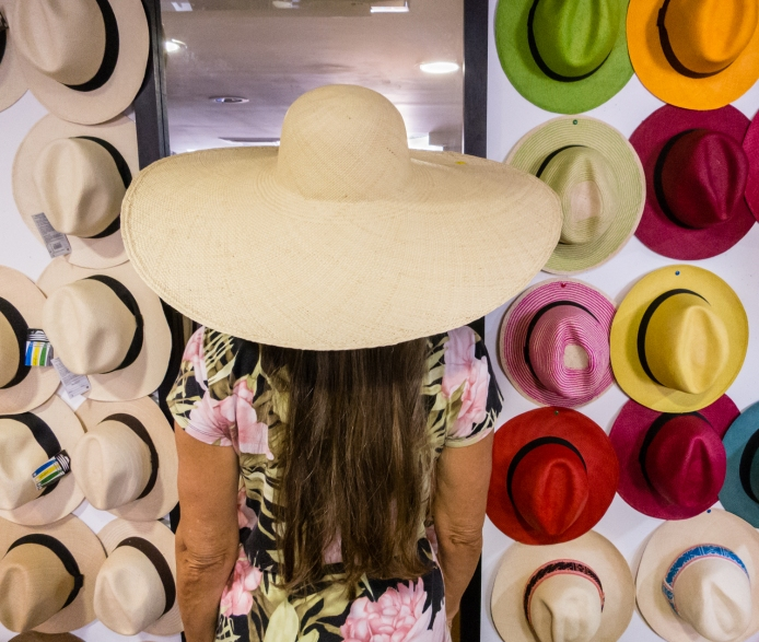 Trying on one of many hat styles at Artesanias de Colombia in El Centro (Old City) Cartagena, Colombia