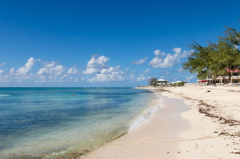 Typical white sand beach and azure waters at Grand Turk, Turks & Caicos