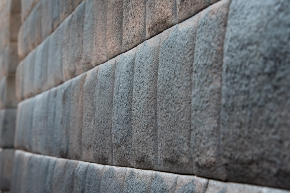 A portion of a foundation wall from the mid-1400s, illustrating the exquisite stone masonry, craftsmanship and architecture of the Incas, Cuzco, Peru