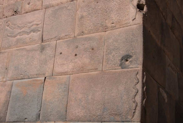 Original 14th century Inca stone block foundation (with carved serpents), upon which the 15th century convent was built that was restored and converted to become Belmond Palacio Nazarenas (Hotel), Cuzco, Peru
