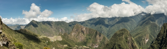 Panoramic view of Machu Picchu, Peru, from the Inca Trail, descending into the valley from the Sun Gate