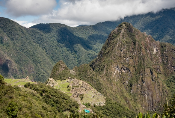 The Inca Trail offers a magnificent view of Machu Picchu, with Huayna Picchu mountain behind it (notice the hiking steps carved near the top) as you hike down from the Sun Gate, Peru