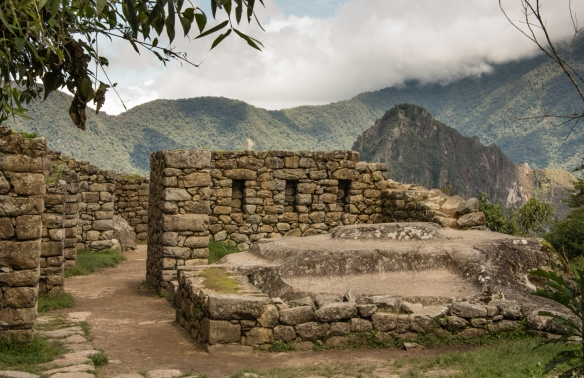 The three tiered holy stone at the pilgrim's temple along the Inca Trail as it descends into Machu Picchu from the Sun Gate, Peru