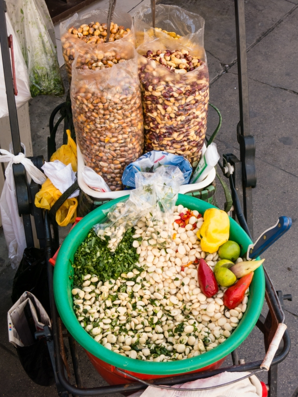 This vendor's street cart features two traditional Peruvian snacks -- white beans and fried corn kernels, Trujillo, Peru