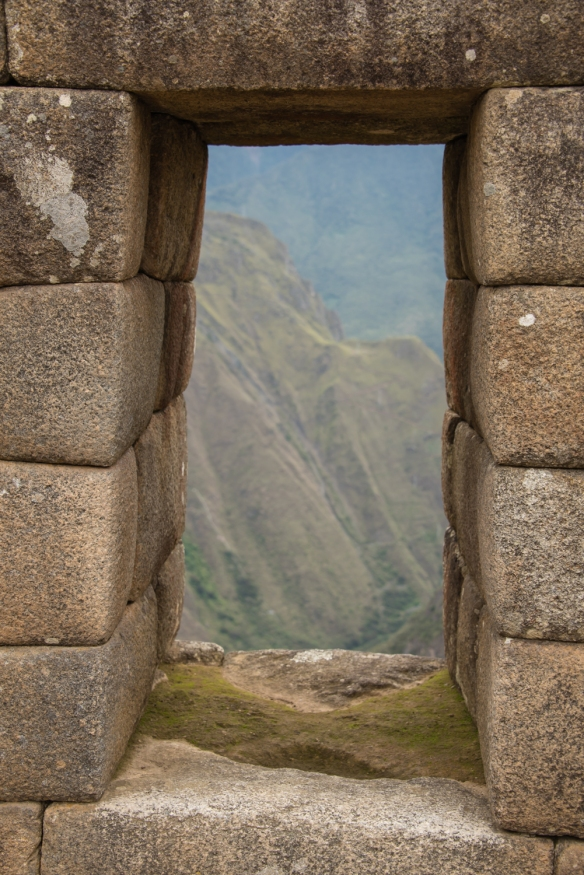 A typical window with a stunning view of the surrounding mountains at Machu Picchu, Peru