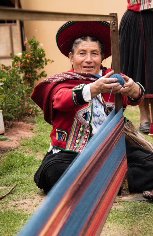 "Chinchero weaver preparing for weaving at the Center for Weavers of Chinchero (""Awayricch'arichiq""), Chinchero (Sacred Valley of the Incas), Peru"
