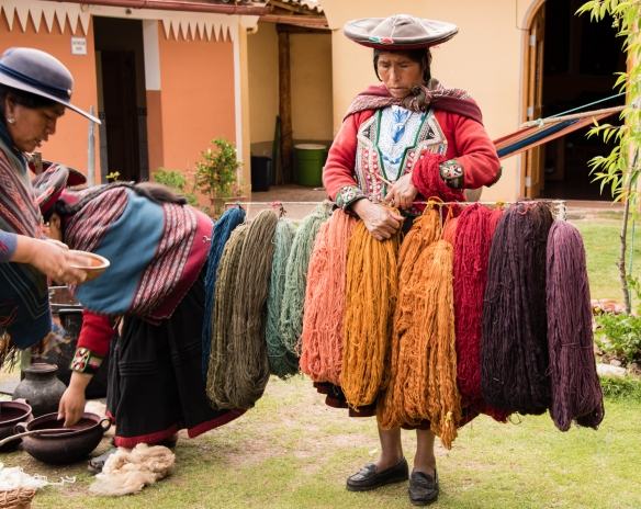 "One of the weavers showing samples of the variety of colors from natural dyes at the Center for Weavers of Chinchero (""Awayricch'arichiq""), Chinchero (Sacred Valley of the Incas), Peru"
