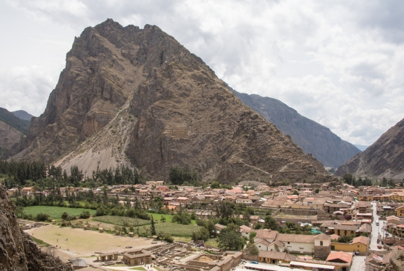 The 14th century Inca city of Ollantaytambo in the Sacred Valley of the Incas; note the stone granary built into the mountain, about 1:3 of the way up, center-right; Peru