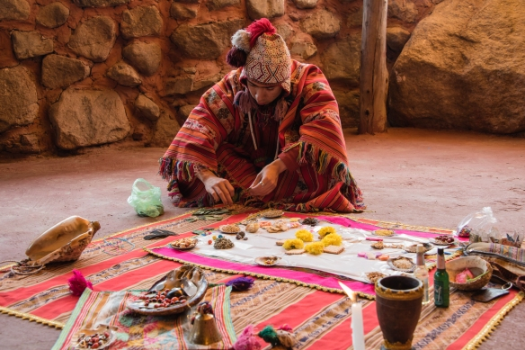 "The son of the medicine man (Andean ""priest"") prepares for the Despacho ceremony (Andean Ritual to Mother Earth), Ollantaytambo, Peru"