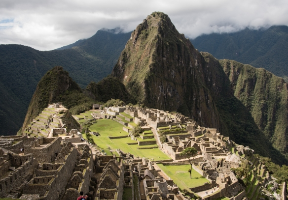 The two urban sectors adjoining the main square at Machu Picchu with the main temple and the Intihuatana stone on the hilltop on the left, center; Peru_