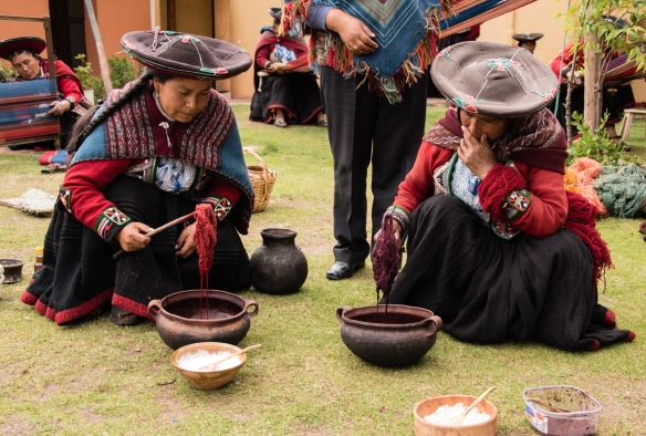 "Two weavers showing the differences in darkness fron natural dyes achieved with the addition of a natural darkener at the Center for Weavers of Chinchero (""Awayricch'arichiq""), Chinchero (Sacred Valley of the Incas), Peru"