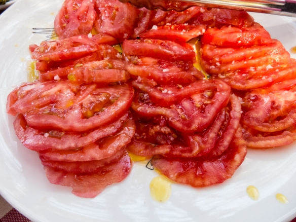 Delicious ripe tomatoes with a touch of local olive oil to accompany the meats and fish at our Chilean barbeque luncheon at the Marchigüe vineyards of Viña Montes winery, Colchagua Valley, Chile