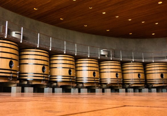 Gravity fed fermentation barrels with internal stainless steel cooling coils at the Lapostelle winery, Santa Cruz, Colchagua Valley, Chile