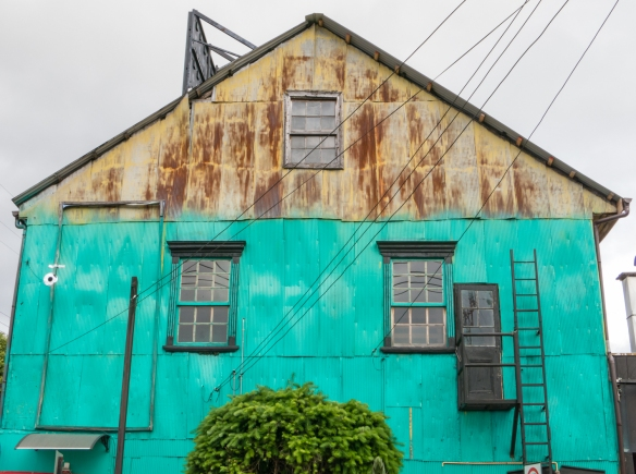 Half-painted old building in downtown Castro, Chiloe Island, Chile