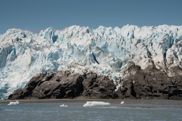 Here you can see how the glacier (solid ice and snow) literally flows down to the Pacific Ocean over the permanent rocks & land;  Pio XI Glacier, Bernardo O´Higgins National Park, Patagonia, Chile
