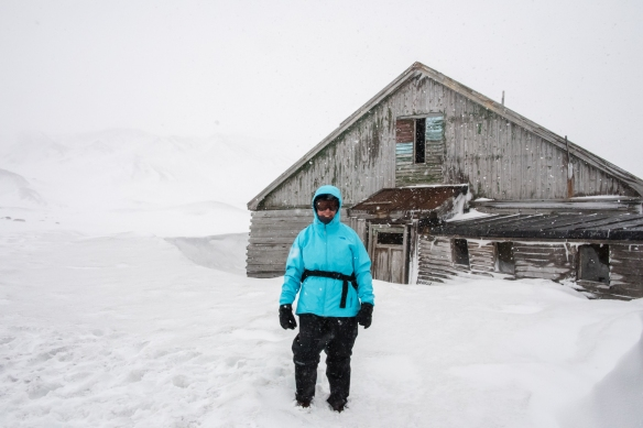 Our intrepid explorer checking out the abandoned whaling station in a blizzard, Deception Island, South Shetlands Archipelago, northwest of the northern tip of the Antarctic Peninsula