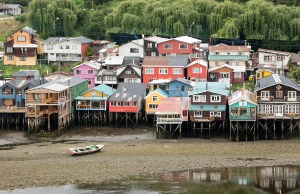 Palafito houses, precarious but picturesque timber houses on stilts, in the Mar y Canela, Castro, Chiloe Island, Chile