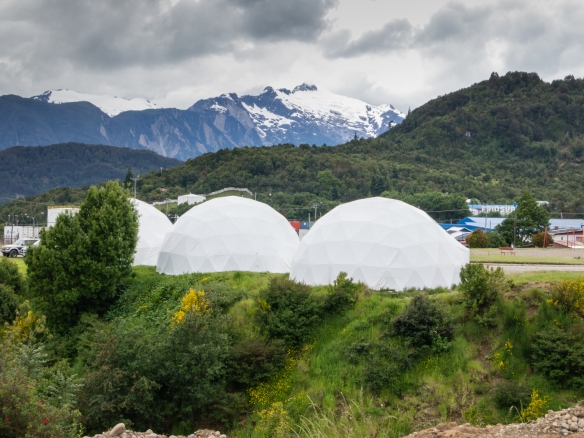 Three interconnected tent domes housing artisans from nearby Puerto Aysén, adjacent to the harbor, Puerto Chacabuco, Patagonia, Chile