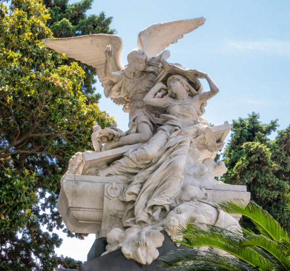 A beautiful marble sculpture adorns the top of a mausoleum near the entrance to Recoleta cemetery, Buenos AIres, Argentina