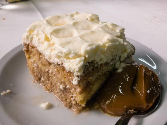 A shared luncheon dessert of delicious dulce de leche cake, El Obrero, in La Boca, Buenos Aires, Argentina