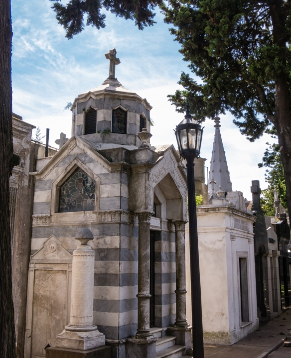 """A small portion of a long """"avenue"""" of individual mausolem """"houses"""", Recoleta cemetery, Buenos AIres, Argentina"""