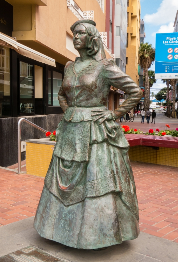 A statue of Mary Sanchez, an interpreter of traditional Canarian music on the Las Canteras beach promenade, Las Palmas, Gran Canaria, Canary Islands
