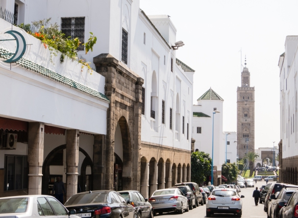 A street in the center of Casablanca, near the Royal Palace, with a minaret at the end of the street, Casablanca, Morocco