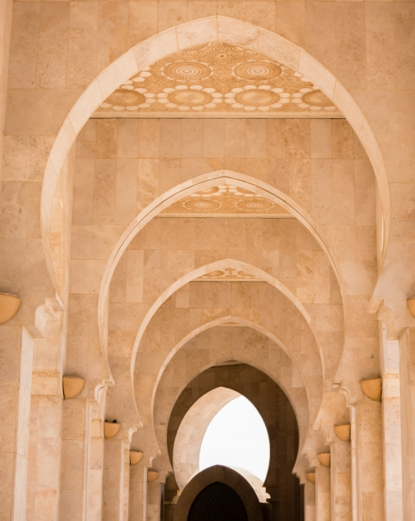 Beautiful cascade of arches in a passageway on the exterior side of La Mosquée Hassan II (Hassan II Mosque), Casablanca, Morocco