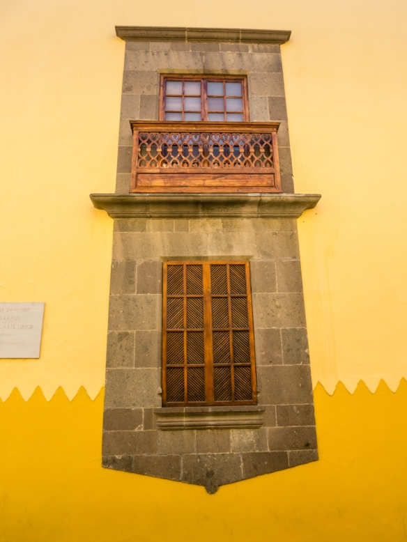 Beautiful wood window shutters and balcony on an old Spanish-style building in the historic Vegueta district, Las Palmas, Gran Canaria, Canary Islands
